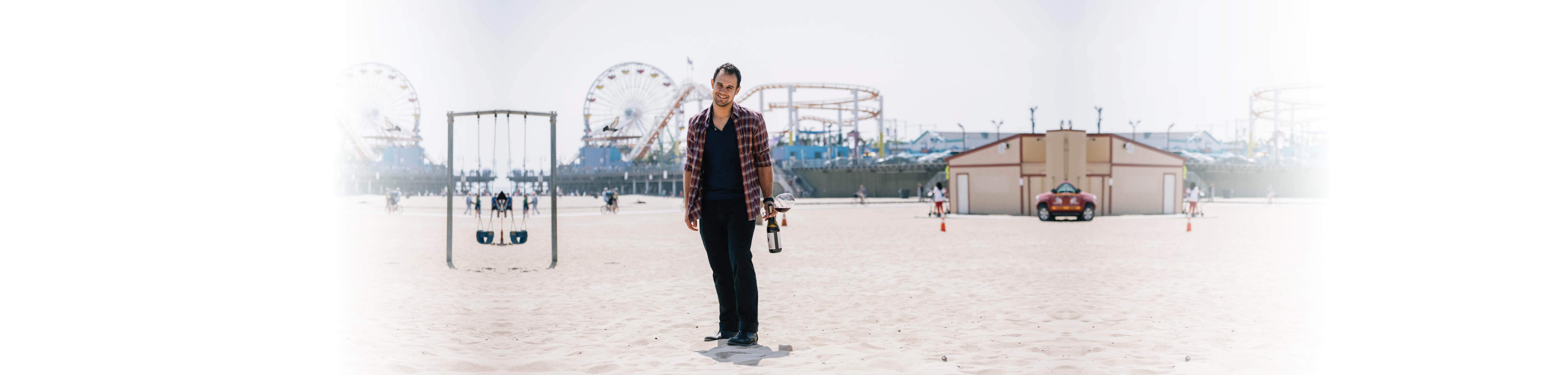 vince anter at santa monica pier with wine
